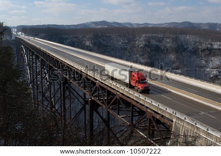 A trucker drives across The New River Gorge Bridge in Fayetteville, West Virginia. - stock photo