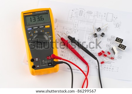 a true rms multimeter and a circuit diagram - stock photo