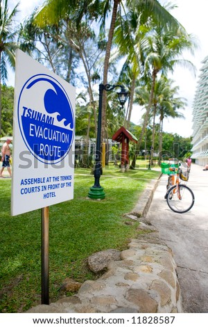 A Tsunami evacuation sign board reminder for hotel guest of place to assemble in the case of tsunami in Phuket, Thailand