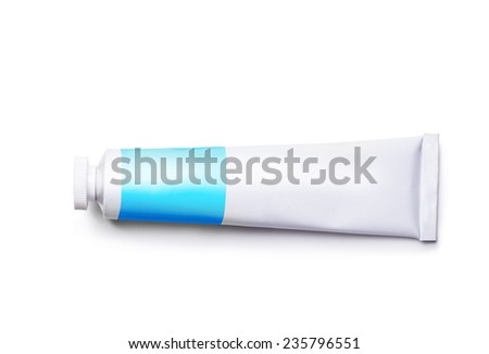 a tube of blue paint on a white background - stock photo