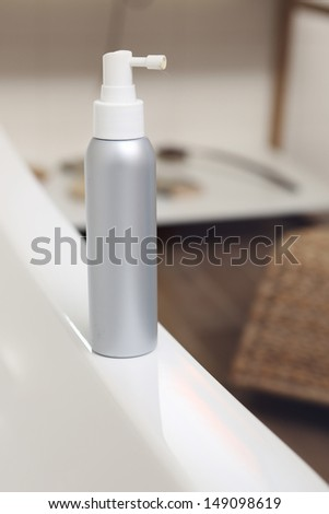 A tube of lotion in the bathroom - stock photo