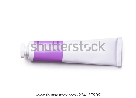 a tube of purple paint on a white background - stock photo
