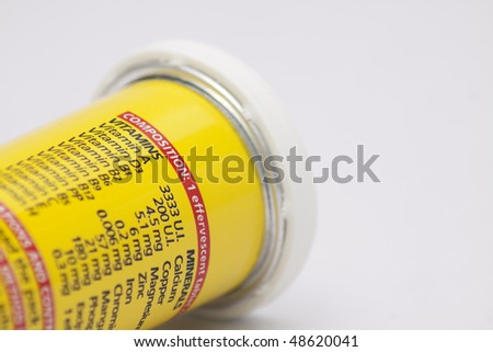 a tube of vitamins on clean background - stock photo