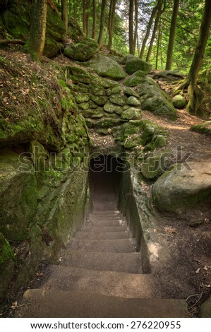 A tunnel carved through the rock along a trail in Hocking Hills Ohio. - stock photo