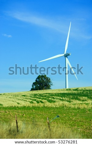 A turbine in a field at wind farm