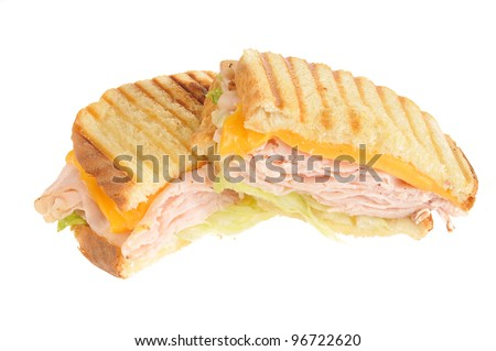 A turkey panini with cheddar cheese on a white background - stock photo