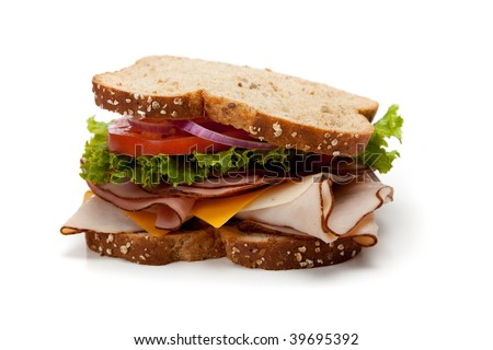 A turkey sandwich on a whole-grain bread with lettuce, cheese and tomatoes on a white background - stock photo