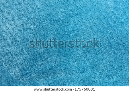 a turquoise blue background of warm, cozy microfleece blanket - stock photo