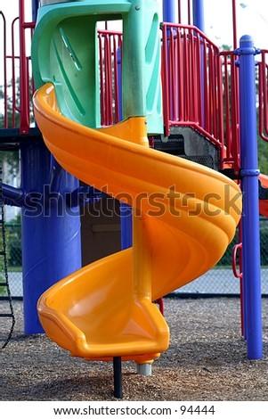 A twisty slide in a children's playground. - stock photo