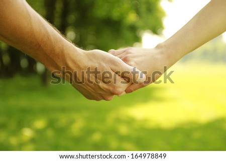 a two hands in love couple on nature