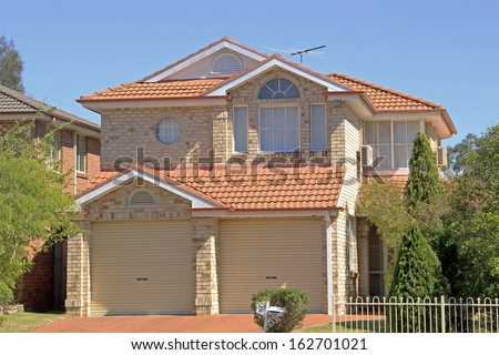 A two storey residential brick house building in Sydney Australia - stock photo