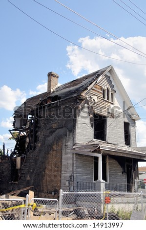 A two story house that recently burned, showing fire damage. - stock photo