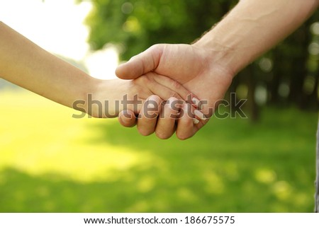 a Two young lovers hands on nature