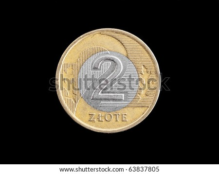 A two zloty polish coin isolated on black - stock photo