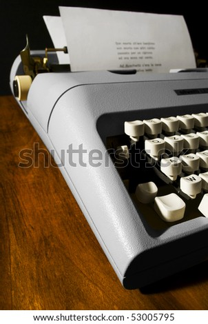 a typewriter on a wooden desk
