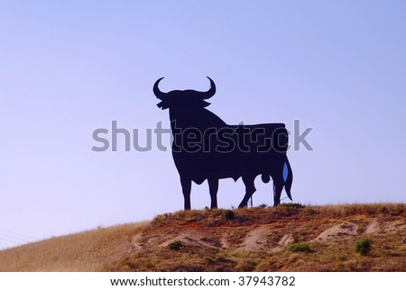 A typical black bull along the spanish roads - stock photo