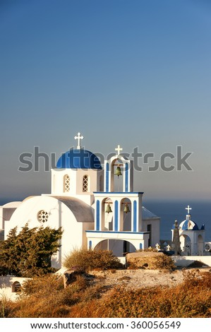 A typical blue domed church situated at Exo Gonia on the Greek island of Santorini. - stock photo