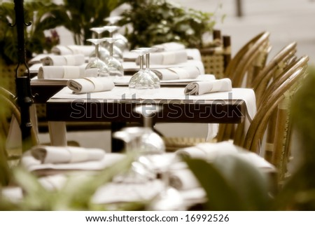 A typical cafe terrace in Paris France - stock photo