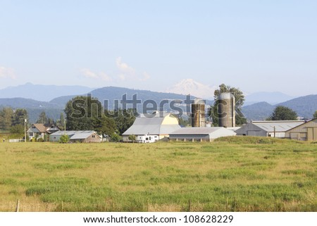 A typical Canadian farm and field in western Canada/Western Canada Farm/A large farm operation in western Canada - stock photo