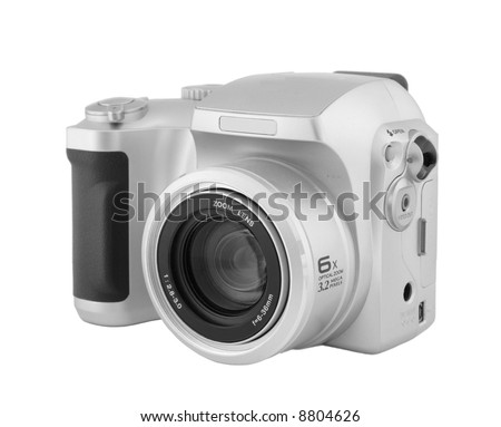 A typical compact zoom digital camera isolated on a white background