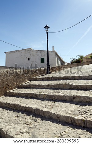 A typical corner of the old town of Ibiza, with its steep streets and whitewashed houses