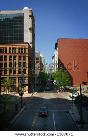 a typical downtown street scene with slanting sun, taken in pittsburgh, PA. - stock photo