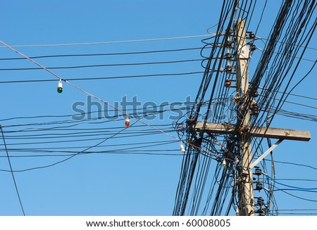A typical electricity pole with a huge amount of connections, as typically found throughout Southeast Asia - stock photo