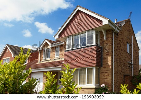 A typical English house with a garden - stock photo