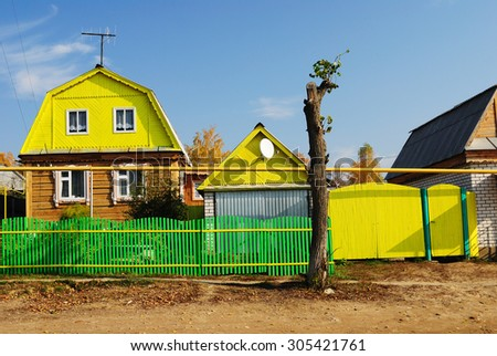 a typical farmstead and outbuildings in Mari El, Russia - stock photo