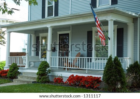 a typical front porch of a home in a small town in the usa featuring an - Front Porch Swing