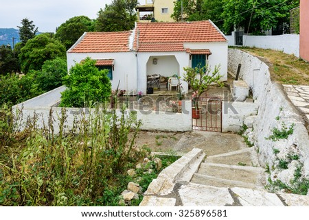 A typical house and its yard in Afionas village, Corfu island, Greece. - stock photo