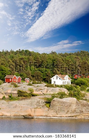 A typical house on the coast of norway - stock photo