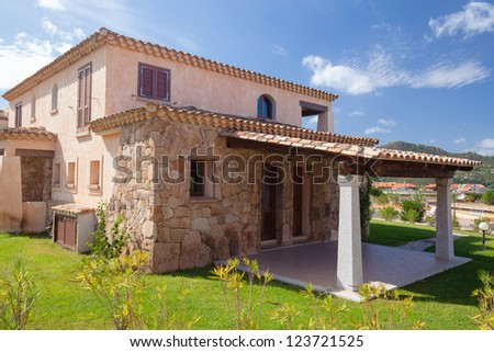 A typical italian house with garden. Photographed from the street. Good for Real-estate koncept. - stock photo
