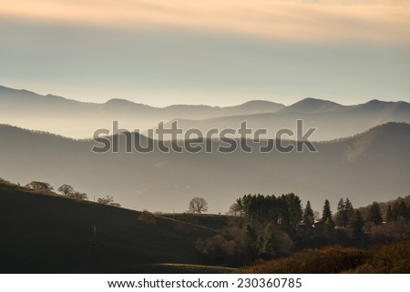 A typical misty sunrise on many mountain farms in the Southern Blue Ridge Mountains of North Carolina. - stock photo