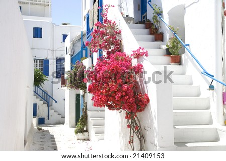 A typical narrow alley in the town of Mykonos, Greece - stock photo