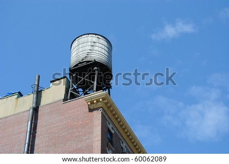 a Typical new york city water tower. - stock photo