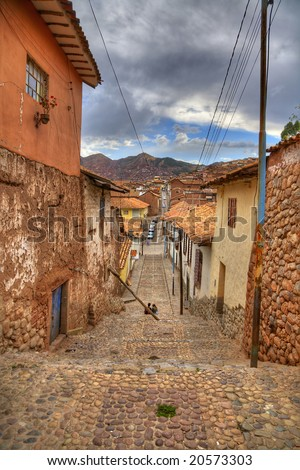 A typical old street in central part of Cusco, Peru - stock photo