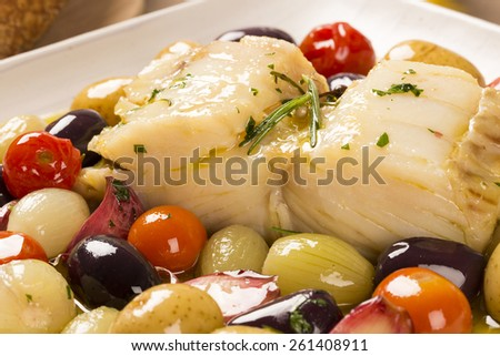 A typical Portuguese dish with codfish called Bacalhau do Porto in a original portuguese plate - stock photo