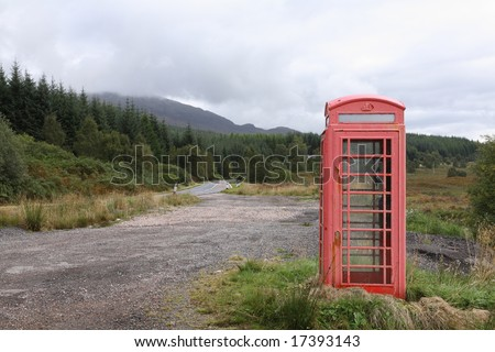 A typical red UK telephone box in a remote location in the Scottish Highlands - stock photo