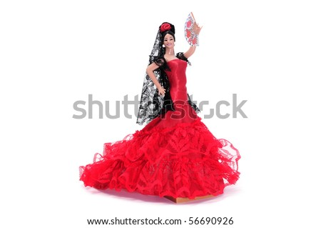 a typical spanish doll dressed as a flamenca isolated on a white background - stock photo