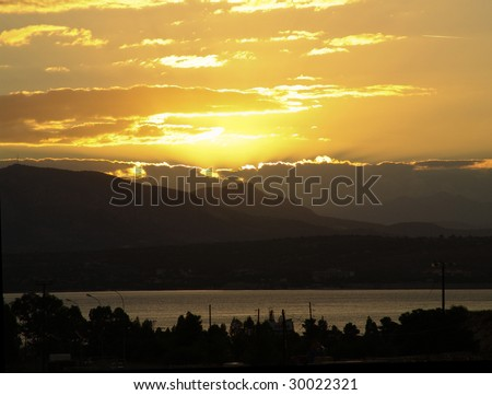 A typical sunset in greece - stock photo