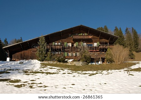 A typical Swiss chalet, near Gstaad - stock photo