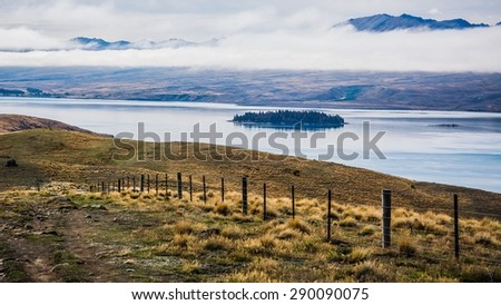 a typical view at lake tekapo in nz - stock photo