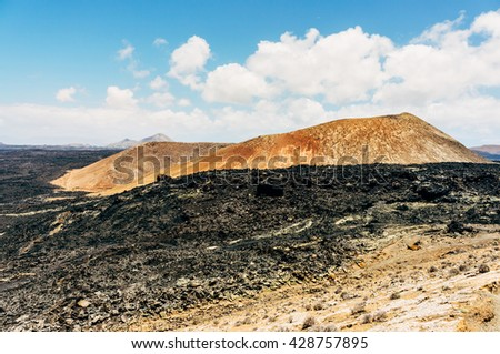 A typical volcanic landscape in Lanzarote, Canary island  - stock photo