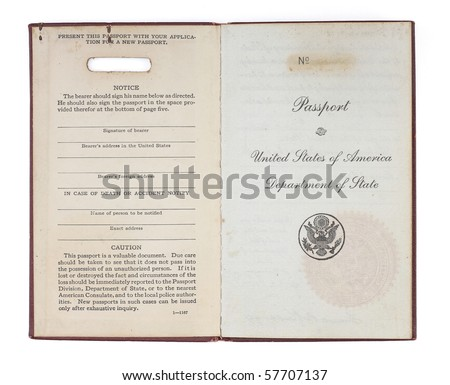 A U.S. Passport from the 1920s open to the inside title page.  Isolated on white with clipping path. - stock photo