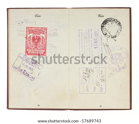 A U.S. Passport from the 1920s open to two facing pages with customs stamps from 1928 Germany and France. Isolated on white with clipping path. - stock photo
