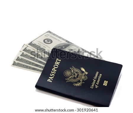 A U.S. Passport with 100 dollar bills isolated against white background