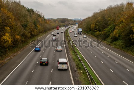 A UK motorway, with limited traffic, on an autumn day - stock photo