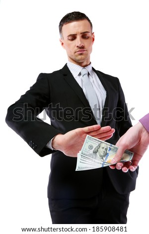 a uncorrupted businessmen refusing money from a bribe isolated on a white background - stock photo