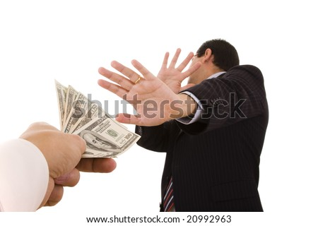 a uncorrupted businessmen refusing money from a bribe (selective focus) - stock photo